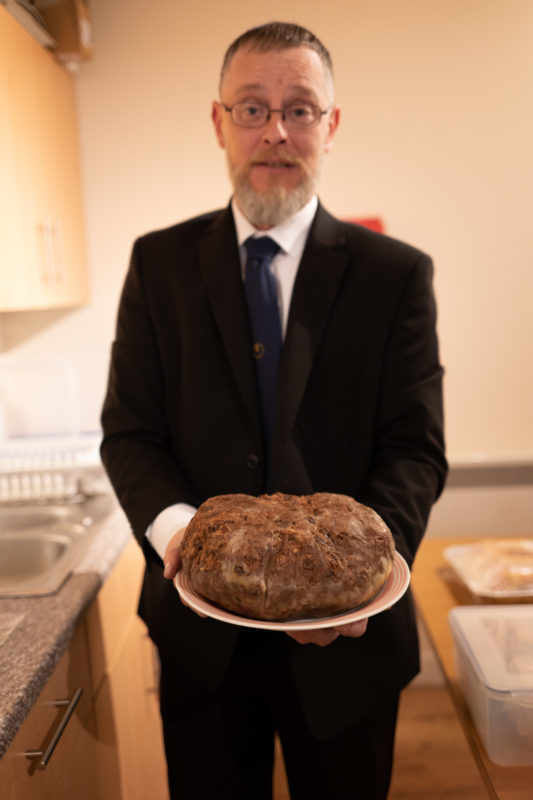 Brian holding the clootie dumpling